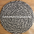 black and white felt ball rug nepal