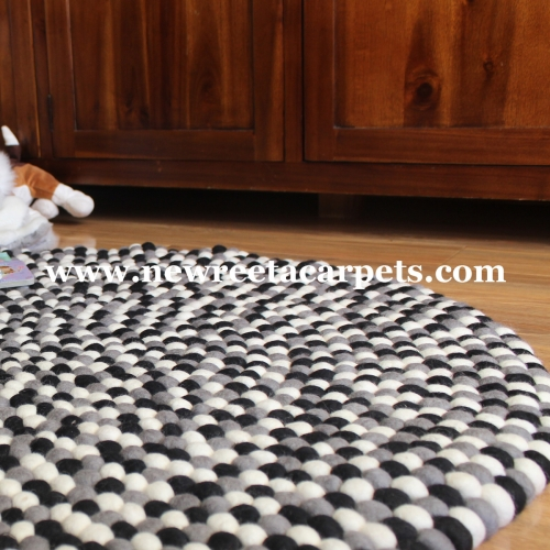 black and white felt ball rug nepal